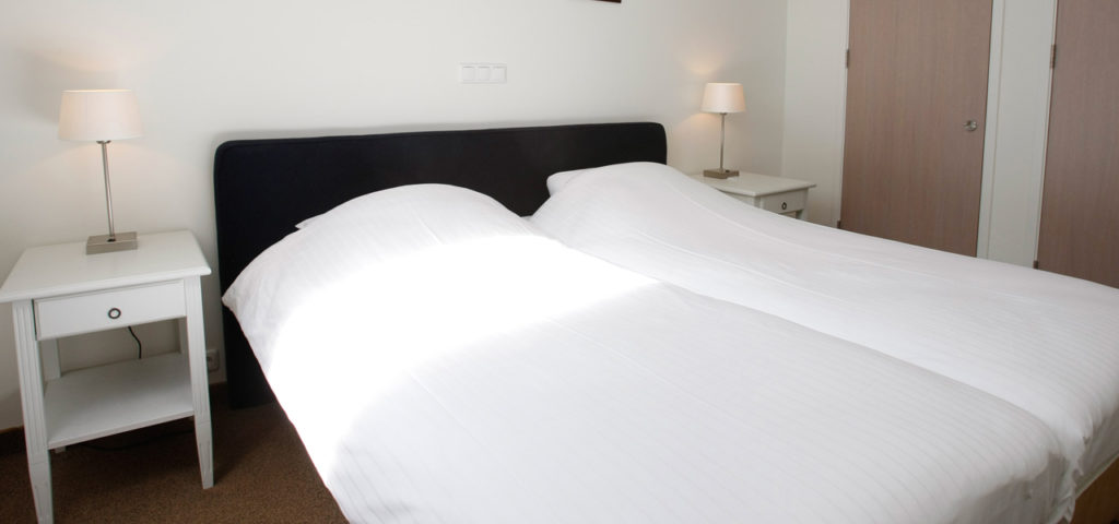 Slaapkamer in appartement Residentie Vlierijck Vlieland - Westcord Hotels
