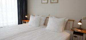 Slaapkamer in appartement WestCord ApartHotel Boschrijck - Westcord Hotels